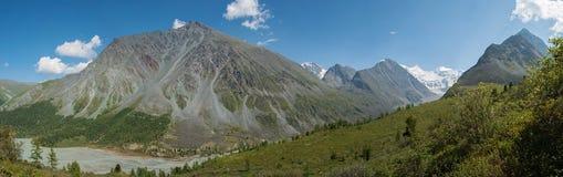 Panorama of the lake Akkem and Mount Belukha. Trekking in the Altai Mountains Royalty Free Stock Photo