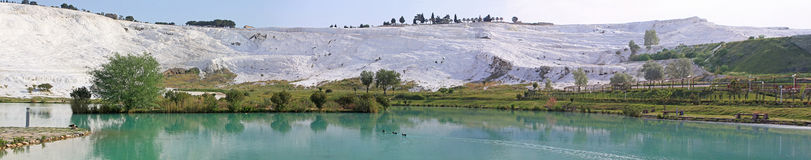 Panorama of lake and calcified limestone terraces, Pamukkale Stock Photos