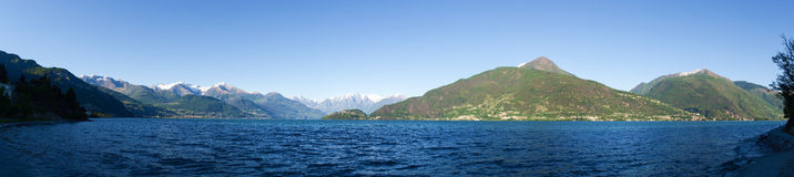 Panorama of the Lake of Como from the Beach at evening sunlight Stock Photos