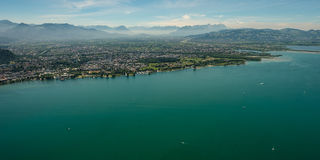 Panorama of lake constance with the city of Bregenz and Dornbirn. And the alps in summer Royalty Free Stock Image