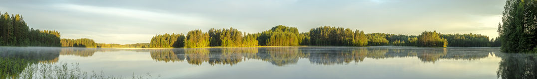Panorama of lake with fog at dawn Stock Images