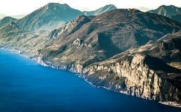 Panorama of Lake Garda seen from the top of Mount Baldo, Italy. Royalty Free Stock Photo