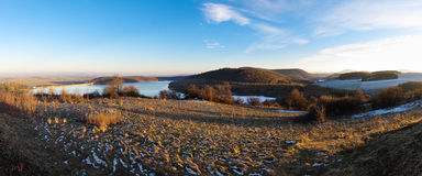 Panorama with lake and hills Stock Images