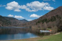 Panorama of lake of Kruth with pedalos ans beautiful cloudy sky. In alsace - France stock images