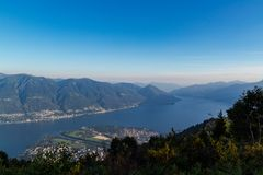 Panorama of the lake maggiore and delta of locarno ascona from cimetta royalty free stock photo