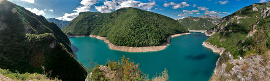 Panorama of the lake in mountains Stock Image