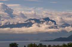 Panorama with lake and mountains. And clouds populated Stock Image