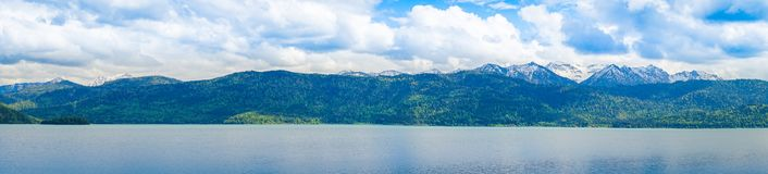 Panorama of Lake with mountains, cloudy sky in background royalty free stock photos