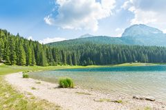 Panorama of lake in mountains Royalty Free Stock Images