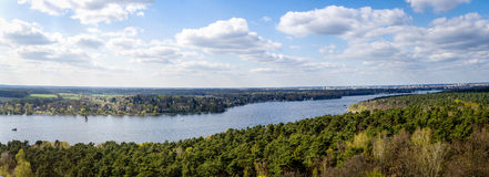 Panorama of lake near Berlin. Panoramic picture of havel see in springtime with cloudy sky Royalty Free Stock Photo