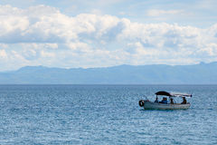 Panorama of lake Ohrid and boat with tourists. Lake Ohrid is a popular destination in Macedonia for leisure and tourism Stock Photography