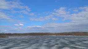 Panorama of the lake or river in the winter. Lake or river covered with ice stock video