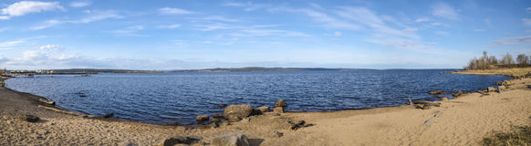 Panorama of lake with sandy beach Stock Photography