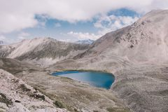 Panorama of lake scenes in mountains, national park Dombay, Caucasus. Russia, Europe. Dramatic blue sky and sunny landscape in summer day royalty free stock photos
