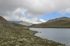 Panorama of lake scenes in mountains, national park Dombay, Caucasus. Russia, Europe. Dramatic blue sky and sunny landscape in summer day stock photo