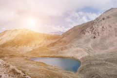 Panorama of lake scenes in mountains, national park Dombay, Caucasus. Russia, Europe. Dramatic blue sky and sunny landscape in summer day royalty free stock photography