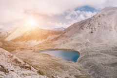 Panorama of lake scenes in mountains, national park Dombay, Caucasus. Russia, Europe. Dramatic blue sky and sunny landscape in summer day stock image