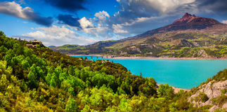 Panorama of lake Serre-Poncon Stock Images
