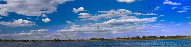 Panorama with lake and sky Stock Image