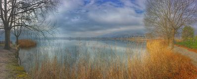 Panorama on the lake in spring Stock Images