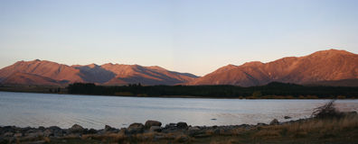 Panorama - Lake Tekapo, New Zealand. Nice sunlight on mountains, lake tekapo, new zealand stock photography