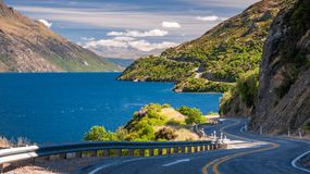 Winding Road on the shore of lake Wakatipu,. Panorama of Lake Wakatipu with the winding road along the lake shore, not far from Queenstown, in the Southern Royalty Free Stock Photo