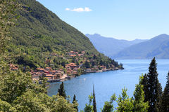 Panorama of lakeside village Fiumelatte at Lake Como with mountains in Lombardy Stock Photography