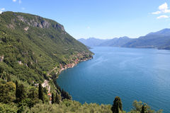 Panorama of lakeside village Fiumelatte at Lake Como with mountains in Lombardy Royalty Free Stock Images
