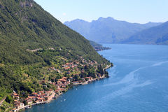 Panorama of lakeside village Fiumelatte at Lake Como with mountains in Lombardy Royalty Free Stock Photography