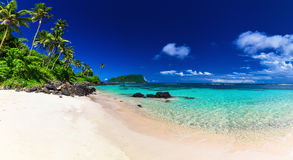 Panorama of Lalomanu beach on Samoa Island with coconut palm tre Royalty Free Stock Images