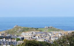A panorama of Land`s End in Cornwall, takes from Saint Ives. On the right, the First and Last refreshments house in England. Saint Ives, Cornwall, England, UK royalty free stock images