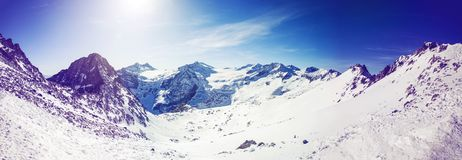 Panorama landscape of alpine mountains on sunny day. Panorama landscape of alpine mountains on sunny winter day Royalty Free Stock Photos