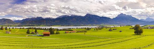 Panorama landscape with alps mountains and lake in Bavaria Royalty Free Stock Photo