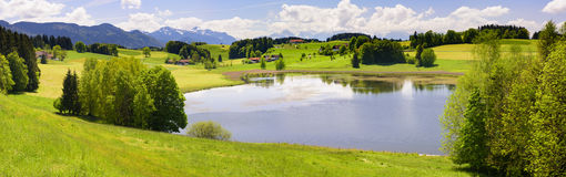 Panorama landscape with alps mountains and lake in Bavaria Royalty Free Stock Photos