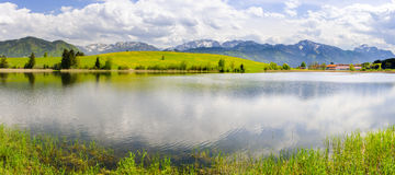 Panorama landscape with alps mountains and lake in Bavaria Royalty Free Stock Images