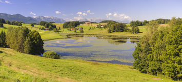 Panorama landscape in Bavaria with mountains and lake Stock Photos