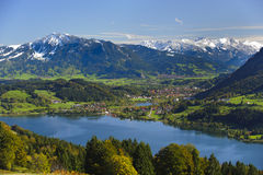 Panorama landscape in Bavaria. Rural panorama landscape with lake Alpsee and alps mountains in Bavaria, Germany, nearby city Immenstadt Stock Images
