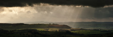Panorama landscape dramatic sky with sun beams over countryside Royalty Free Stock Photography
