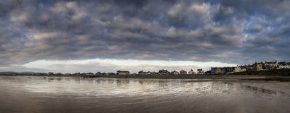 Panorama landscape of dramatic stormy sky over seaside town Stock Image