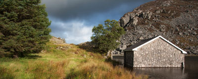 Panorama landscape fishing hut on mountain lake Royalty Free Stock Photography