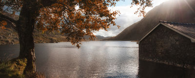 Panorama landscape fishing hut on mountain lake in Autumn Stock Photography