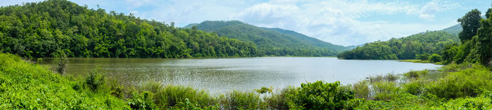 Panorama landscape of green lake with mountain Royalty Free Stock Photography