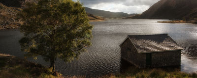 Panorama landscape hut on mountain lake Royalty Free Stock Images