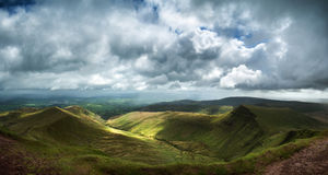 Panorama landscape image of view from peak of Pen-y-fan in Breco Stock Image