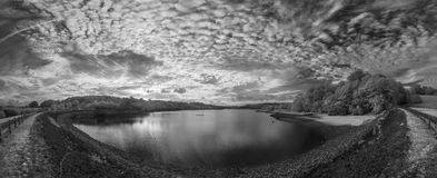 Panorama landscape in infrared of lake in English countryside in Royalty Free Stock Photos