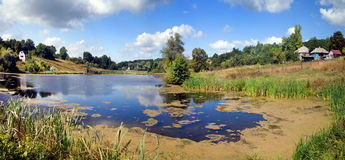 Panorama of landscape lake in Ukrainian. And sky Royalty Free Stock Photo