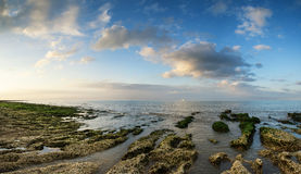 Panorama landscape looking out to sea with rocky coastline and b Royalty Free Stock Images