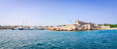 Panorama landscape of Rhodes castle with city harbor Stock Image