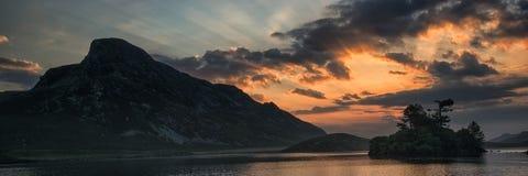 Panorama landscape stunning sunrise over lake in mountains Stock Image