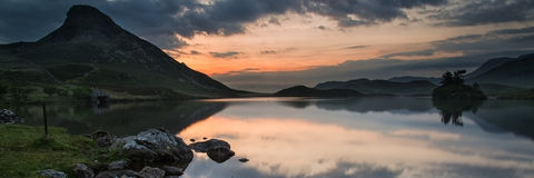 Panorama landscape sunrise over lake mountain Royalty Free Stock Photo